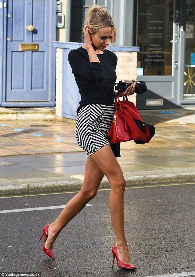 Kimberley Garner stepped out in sailor mini skirt with contrasting horizontal and diagonal stripes and the double zips on both hips add a tougher edge. This little monochrome beauty is by Patrizia Pepe.  the + the red stilettos and purse