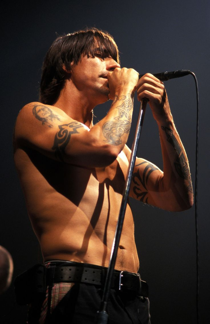 Anthony Kiedis is an American singer-songwriter, best known as the vocalist/lyricist of the Red Hot Chili Peppers. Turned 50 in Nov. 2012. Buffer than buff, held up as the model of healthy living by Men's Fitness magazine, and very likely to outlive the cockroaches that will outlive the apocalypse. A musclebound body eating a mostly vegetarian diet.
