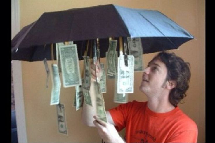 Buy a cheap umbrella from the dollar store and dangle some dollar bills inside, so when opened up there's a little something for a rainy day!
