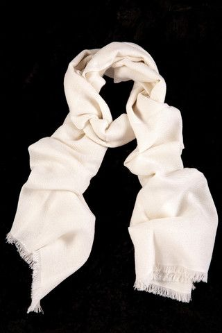 Winter White 100% Cashmere Shawl:   Brilliant snow white for a clean, classic and sophisticated look. This soft, featherlight cashmere shawl exudes purity and warmth for those cozy winter nights.  Features include:      100% Cashmere      Handwoven with French cut ends      Size - 75 x 195 cm      Weight - 175g   Karma Pashmina shawls are authenticated with a Chyangra Pashmina logo. This hallmark guarantees that the highest quality and most genuine cashmere is used in our product…