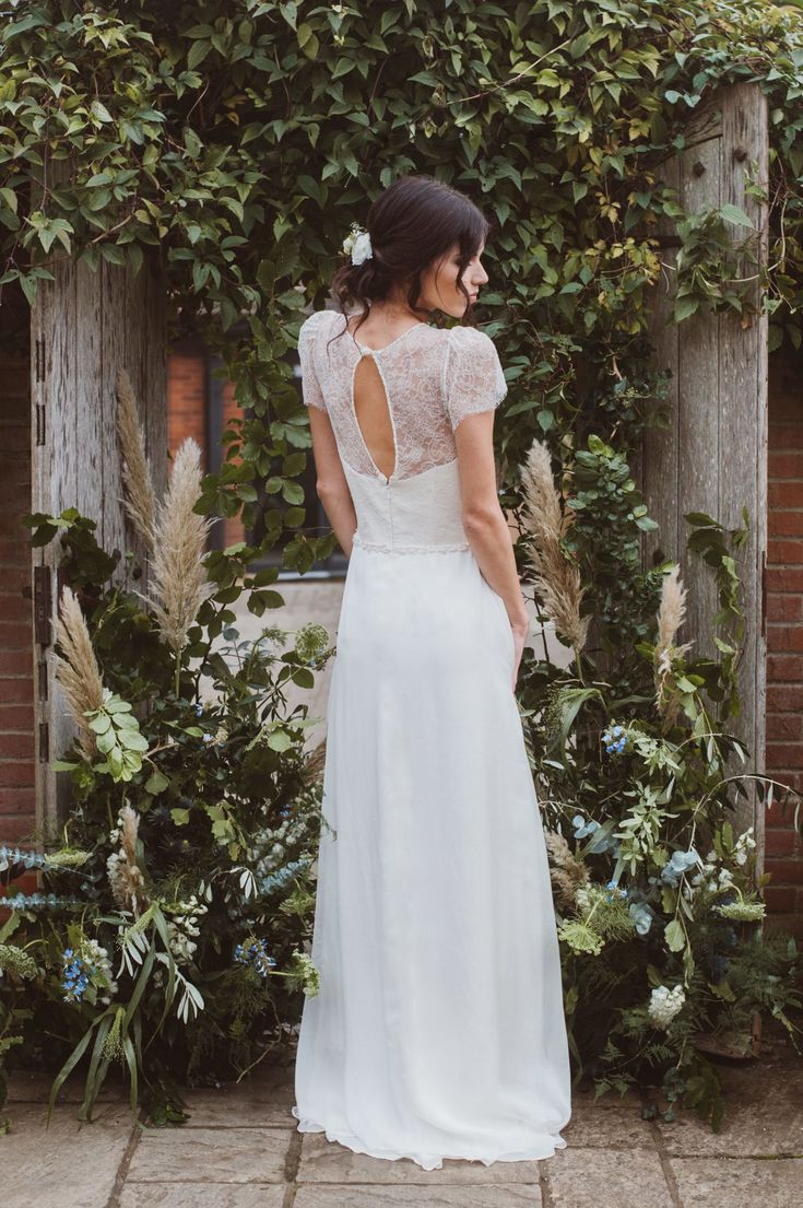 Cowslip Dress by Jessica Turner Designs.  Simple yet elegant wedding dress with chantilly lace and open back. Photography by Kitty Wheeler Shaw