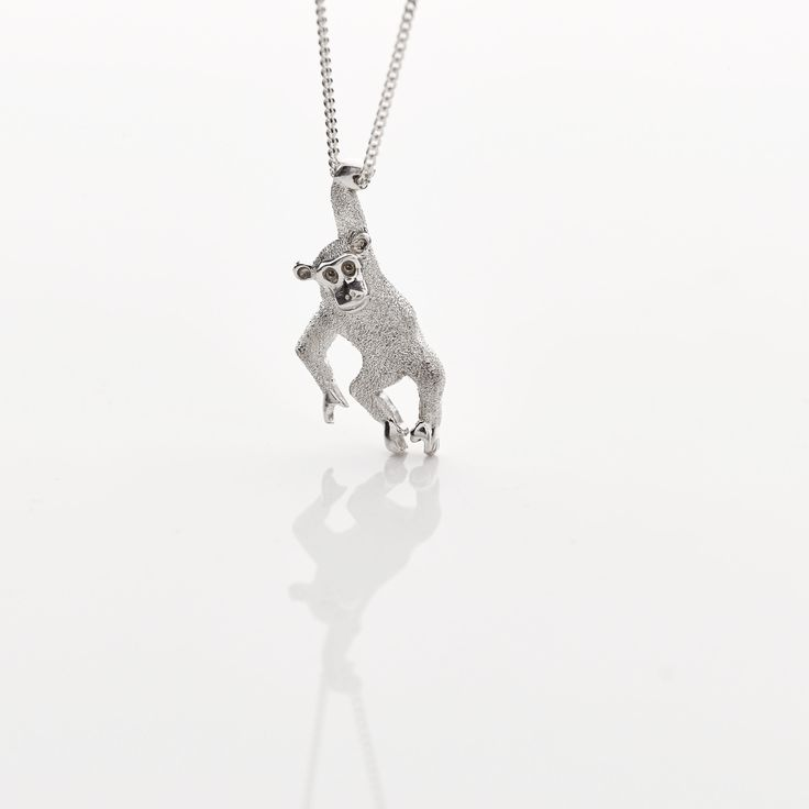 Sterling silver limited edition chimp pendant created for the Jane Goodall Institute SA