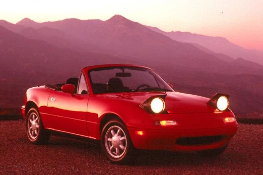 #TBT Taking it back old school with the 1990 Mazda​ Miata, the first time Mazda used the pop-up headlights. Are you winking at us pretty lady? #MazdaFWB #DrivenByService #ZoomZoom #MazdaMiata