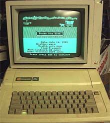 Playing Oregon Trail on the old Apple Computers at school. Yep, just like this.  Thought it was awesome with the blinking wagon going across the screen in green and white.