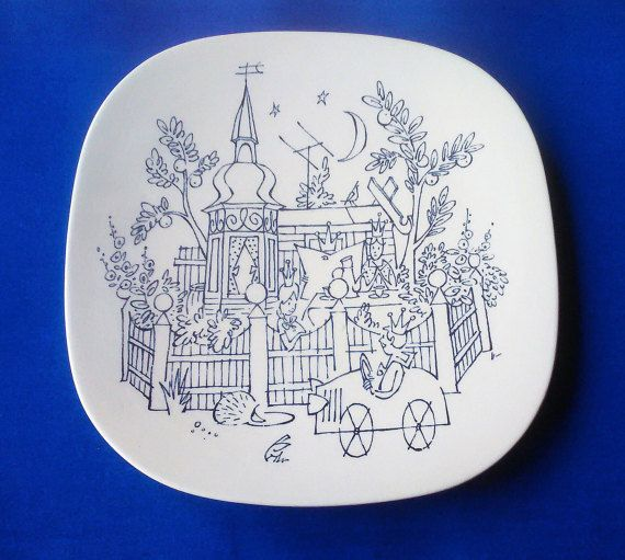 White faiance wall plate or serving dish from Nymolle Denmark with blue decorations - by Danish artist and illustrator Arne Ungermann (1902-1981)  Arne Ungermann is one of Denmark´s most beloved cartoonist of all time. He worked for the newspaper Politiken for over 50 years and has illustrated numerous children´s books - every danish child knows Palle Alene i Verden or Niels All Alone - and every dane loves and adores his illustrations from MATADOR - an epic TV series from the late 70s/e...