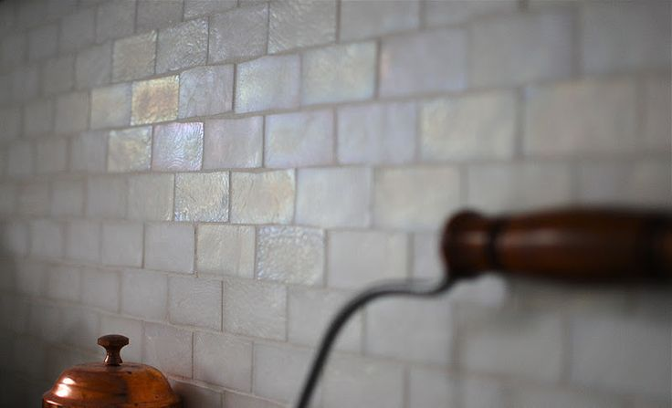 amazing mother of pearl looking subway tile back splash