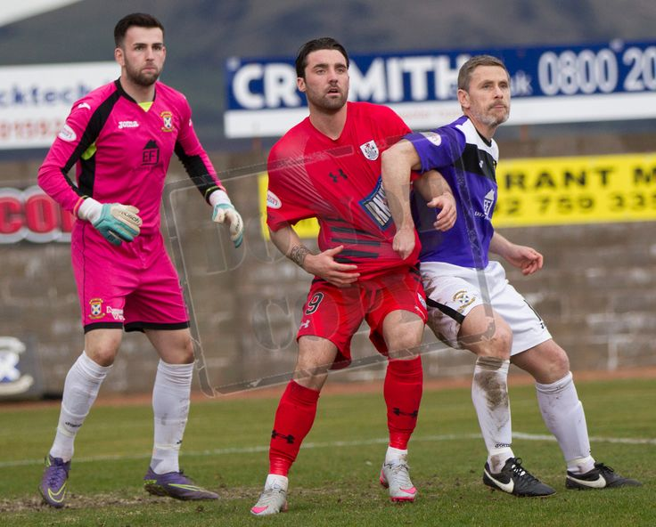 Queen's Park's Chris Duggan tightly marked during the SPFL League Two game between East Fife and Queen's Park.