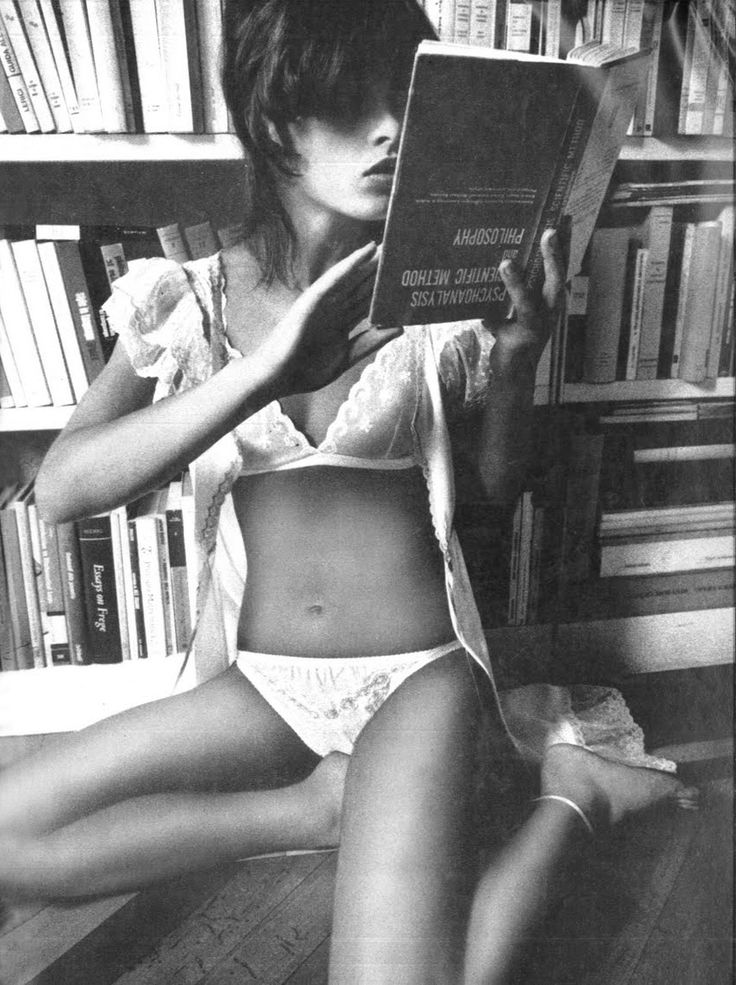 Uschi Obermaier | Vogue Italia by Jeanloup Sieff, July 1972 | reading | library | book | lingerie | 1970's | fashion editorial | kneel | upside down |