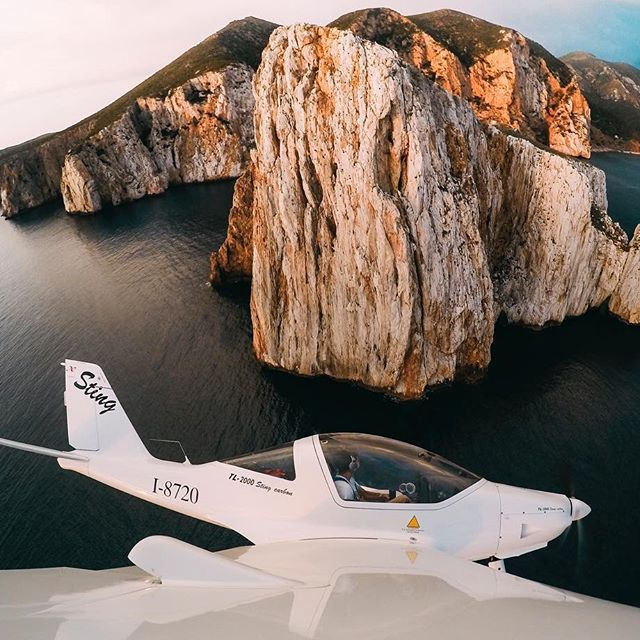 Photo of the Day: @simonepirodda + his trusty #wingman buzzing the coast of #Italy while leveraging Time Lapse mode to capture the action. • • • @sardiniaflyingtours @GoProIT #GoProIT #flying