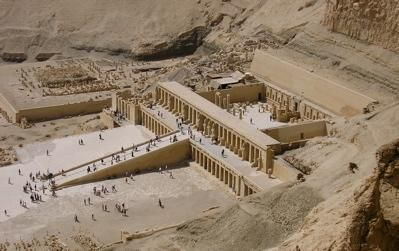 """The Mortuary Temple of Queen Hatshepsut, the Djeser-Djeseru (""""Holy of Holies""""), is located beneath the cliffs at Deir el Bahari on the west bank of the Nile near the Valley of the Kings in Egypt. The mortuary temple is dedicated to the sun god Amon-Ra and is located next to the mortuary temple of Mentuhotep II, which served both as an inspiration, and later, a quarry. It is considered one of the """"incomparable monuments of ancient Egypt."""": Temples Built, Temples Luxor, Hatshepsut Temples, Mortuari Temples, Queen Hatshepsut, Ancient Egypt, Luxor Egypt, West Banks, Tours Egypt"""