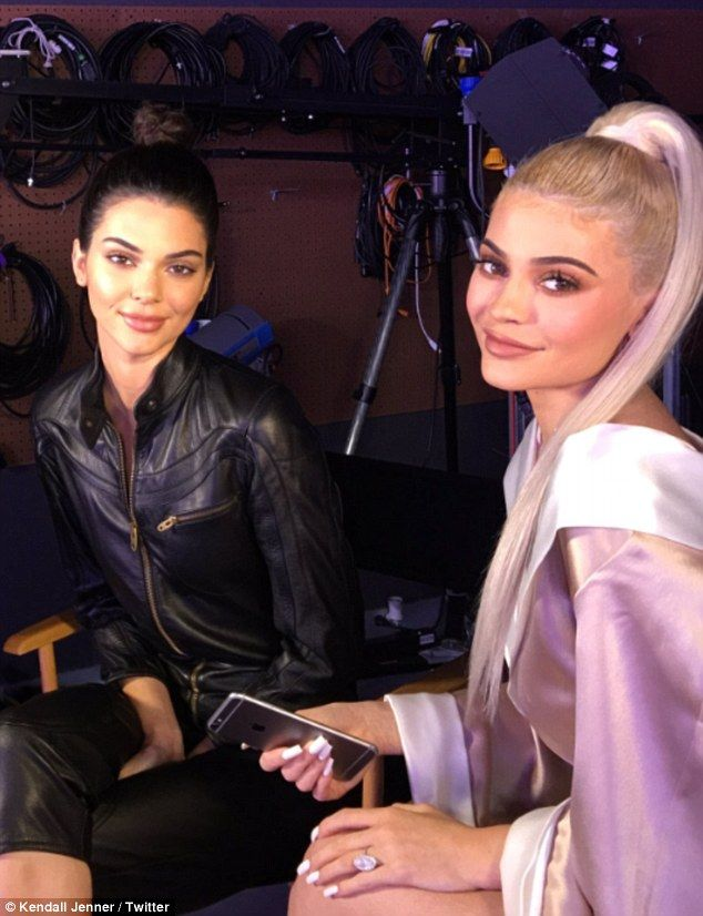 Plumper pout: Kendall Jenner's Twitter picture instantly sparked lip injection rumors as she sat next to sister Kylie during an interview to promote their new book on Monday