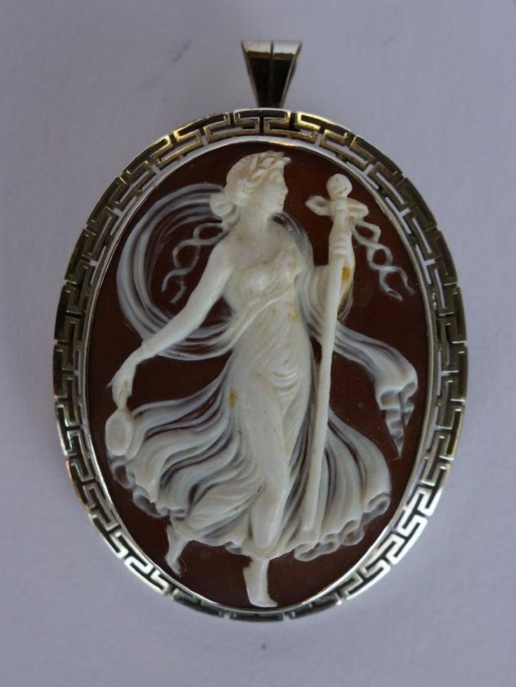 Carved shell cameo. c.1900. Depicts a Greek Goddess with a staff in one hand and a mirror in the other