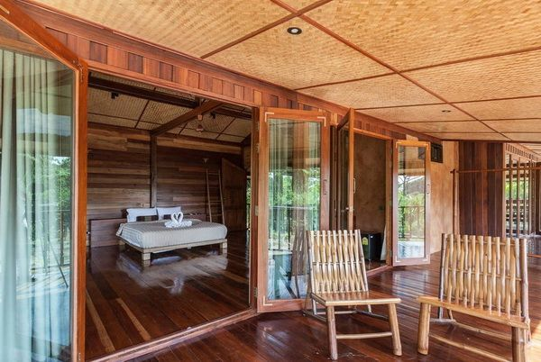 Half Concrete Half Wooden 2 Storey Resort House 3