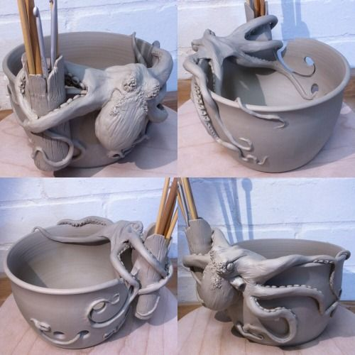 Octopus yarn bowl. Unfired. This bowl has the additional feature of a knitting needle/crochet hook holder in the form of a hollow log that the Octopus has in its grip. The Octopus is climbing over the top of the bowl and several of its tentacles have already found themselves exploring the inside of the bowl. By Joanna Mann, EarthWoolFire. SO COOL!