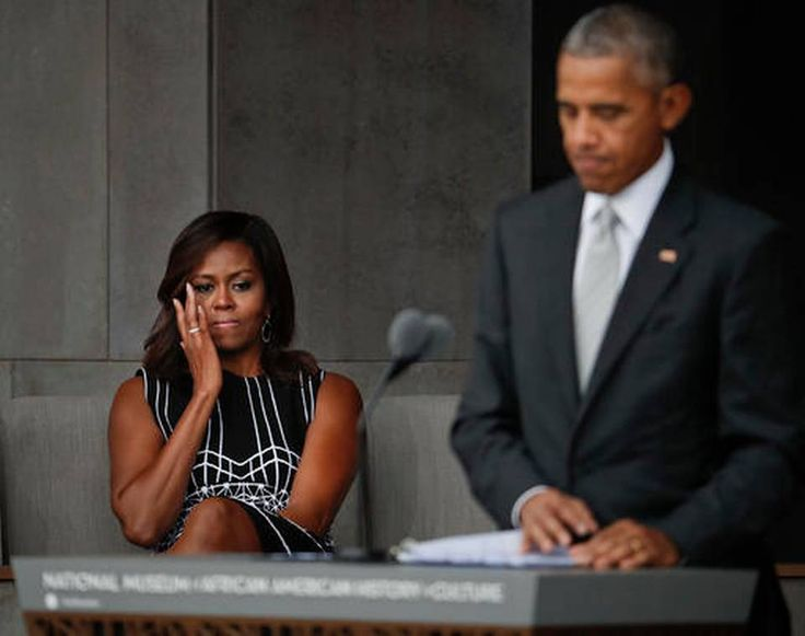 First lady Michelle Obama wipes aways tears as she listens to her husband President Barack Obama speak at the dedication ceremony for the Smithsonian Museum of African American History and Culture on the National Mall in Washington, Saturday, Sept. 24, 2016.