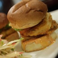 Delight your taste buds with this burger recipe. A burger made with chicken, fish fillets, tomatoes and a tangy hot and sour sauce.