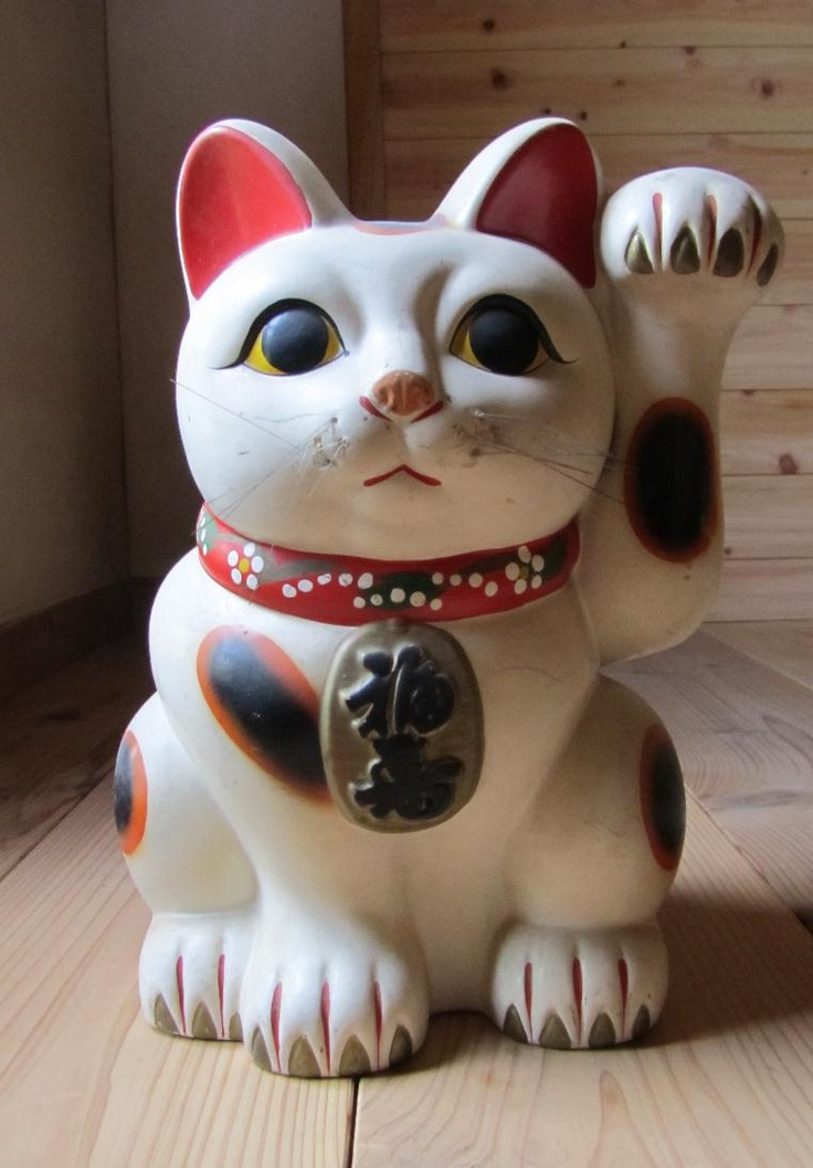 Maneki Neko 招き猫:Welcoming Cat, Lucky Cat, Money Cat, or Fortune Cat) is a common Japanese figurine (lucky charm, talisman), usually made of ceramic, which is believed to bring good luck to the owner.