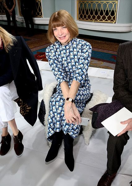 Anna Wintour Print Dress - Anna Wintour sat front row at the Sies Marjan fashion show wearing a high-neck print dress and black suede boots.