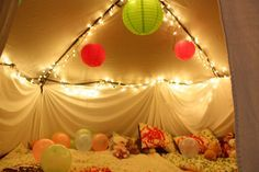 Sleepover Birthday party idea??? CUTE! We used our 8x8ft tent I have for my craft shows and set it at its lowest height. Covered it with white sheets, added lights, blankets, pillows, balloons and decoration on the inside. It was an instant hit. Our little one played for hours in the 'tent'!