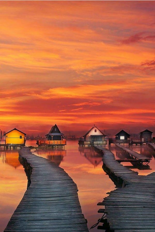 Fishing houses at sunset - Bokodi-Hutoto Lake, Hungary  (by Arturas Burming on Flickr)