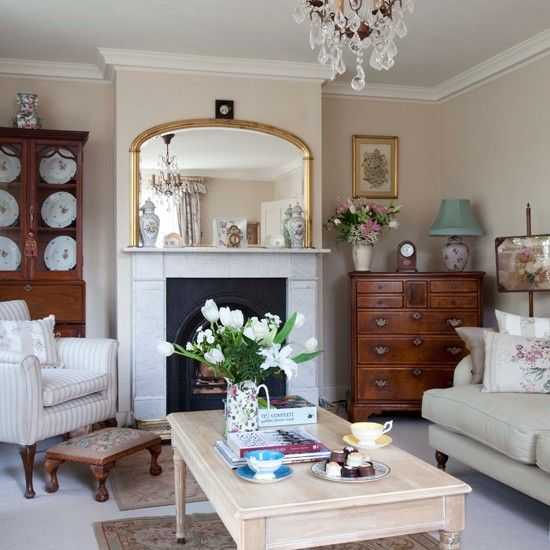 Cream traditional living room.  The neutral walls give a sense of calm, whilst antique funiture and embroidery add a vintage element to this traditional living room.