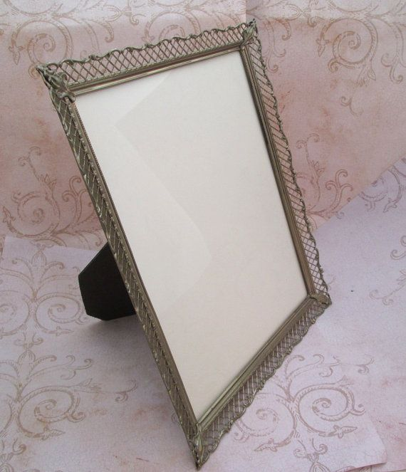 """gorgeous vintage metal filigree 8 x 10 picture frame .. beautiful pierced metal work in antique gold tone colours and sweet baroque style corner motifs / original clear glass and backstand of burgundy velveteen  stand up display ready // wall mount option with attached ring // perfectly fabulous for your precious family photos, your wedding photos, diploma, artwork //  Frame Size - 9"""" wide x 11"""" tall //  will accommodate photo approx 8"""" x 10"""""""