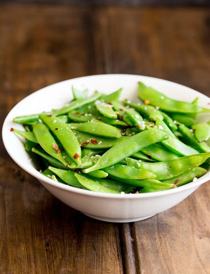 Whip up this 5 Minute Sugar Snap Peas With Chili Salt recipe in no time!