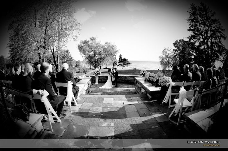 Paletta Mansion wedding ceremony on patio overlooking lake