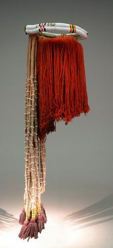 Pondo women wore decorative wigs or headdresses during the late 19th and 20th centuries.