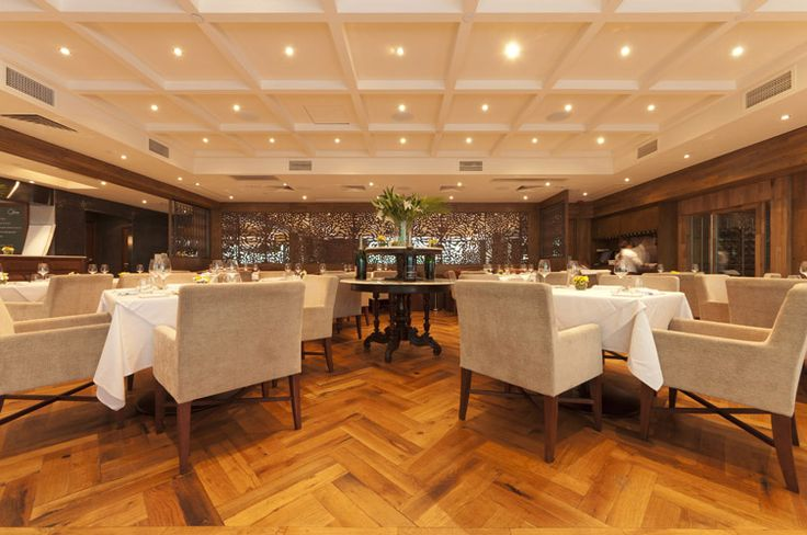 Antique French Oak parquetry flooring beautiful for restaurant applications.