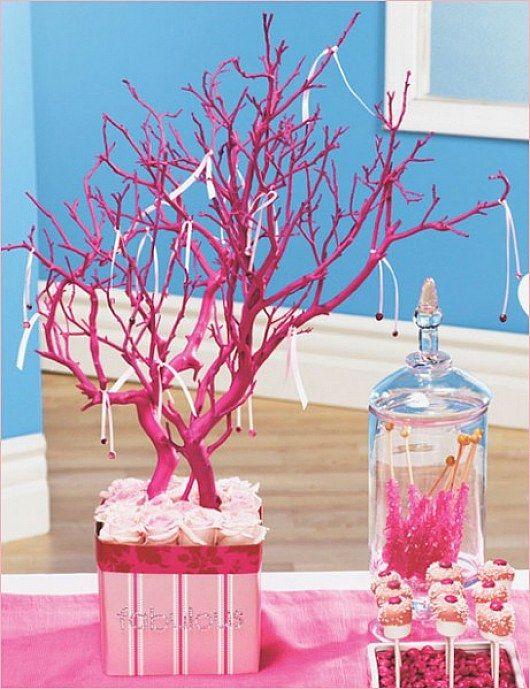 Love this pink tree branch centerpiece found over
