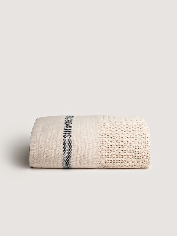 """SENOVINIS COTTON BLANKET  Senovinis is Lithuanian for """"old-fashioned. A timeless take on a classic open-weave, cotton blanket which may become your new family heirloom. Perfect atop a bed, also makes an ideal throw."""
