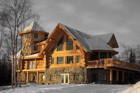 Love the log cabin look and the amazing porch!