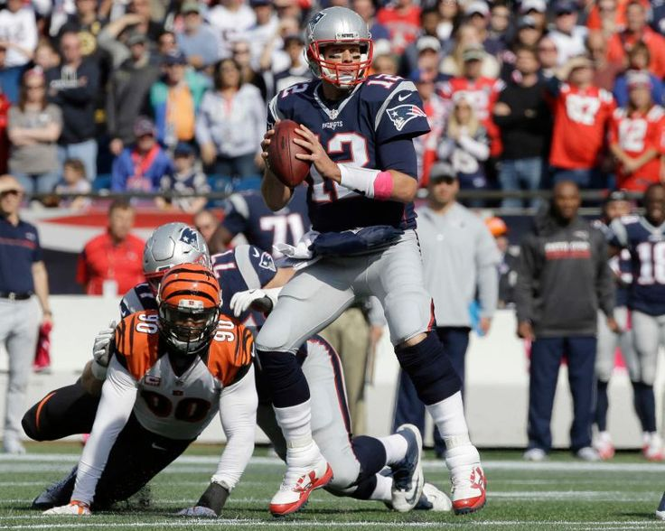 Bengals vs. Patriots:     October 16, 2016  -  35-17, Patriots  -     New England Patriots quarterback Tom Brady looks for a receiver as Cincinnati Bengals defensive end Michael Johnson (90) pursues during the first half of an NFL football game, Sunday, Oct. 16, 2016, in Foxborough, Mass.