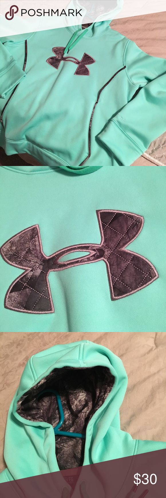 Under Armour hooded pullover Brand new condition...worn once, washed gently and hung to dry.  This just isn't my color. (Mint green/camo)  🙁 Under Armour Tops Sweatshirts & Hoodies