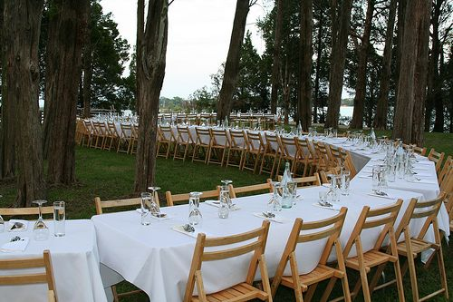 have the tables set up like this (but less) and then the center of attention (bride & groom) inside the half circle. -wedding reception