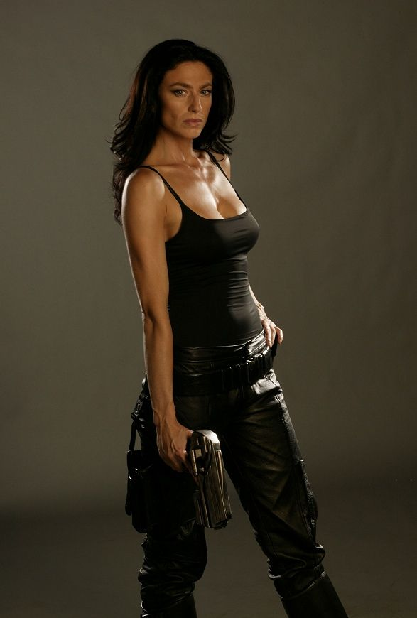 "Claudia Black as either Aeryn Sun in ""Farscape"" OR Vala Mal Doran in ""Stargate.""  I'm sure the gun makes in a no brainer for some fans...but MY memory isn't THAT good ;-)"