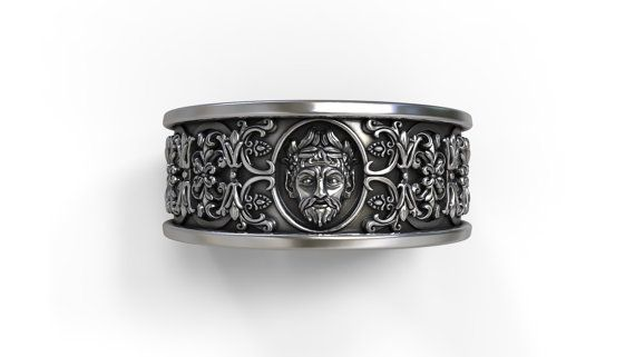 Gothic band comfort fit, with an intricate design surrounding the band and mascaron (mask) representing god Zeus