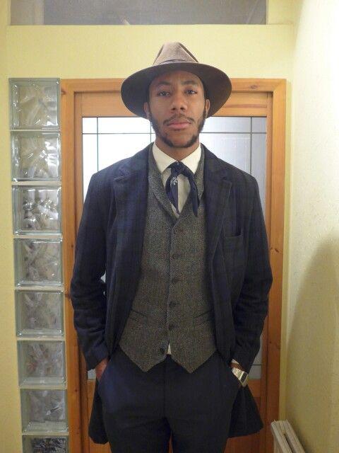 La Touche wears : Hat : Lock & Co Hatters Bandana: vintage Shirt: Lacoste Waistcoat : River Island Overcoat: Debenhams Trouser:Austin Reed