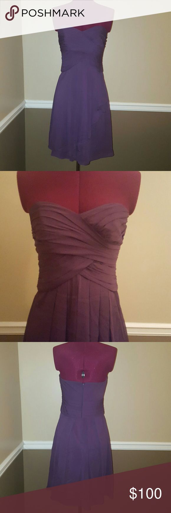 """Plum chiffon bridesmaid dress This dress hugs your curves and the sweetheart neckline is the icing on the cake. There's a rip in the fabric(see pics) but can be taken to David's bridal to fix or DIY. Other measurements are: from top of bust to bottom hem 30"""". Please ask any questions you have and I hope you day is wonderful!! David's Bridal Dresses Strapless"""