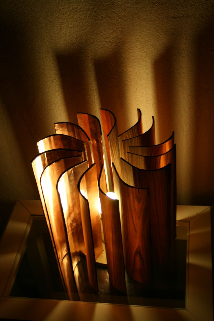 UNSW industrial design project....Lachlan Nicholls created this wonderful lamp using NAV veneer laminated onto a copper shim to give it a orange glow.