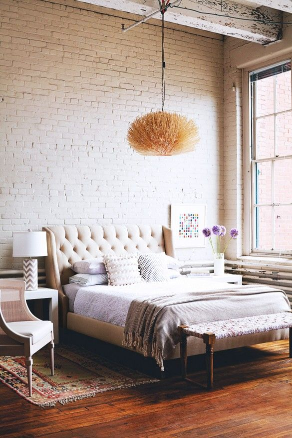 Painted brick in a bedroom with textured pendant