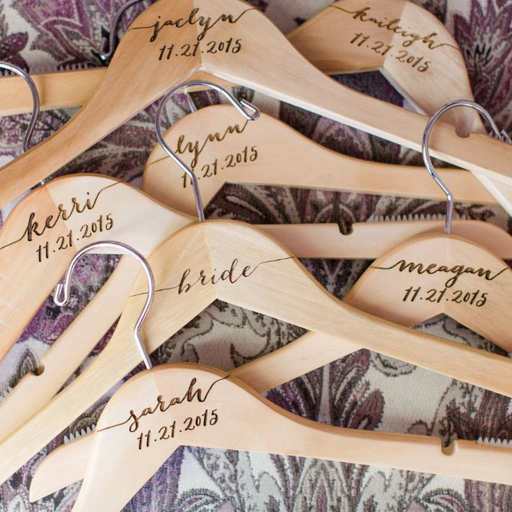 Custom engraved wooden hangers for the wedding bridal party. We offer personalized hangers for the bride, groom, bridesmaids, and the entire wedding party. These hangers are engraved to order and are