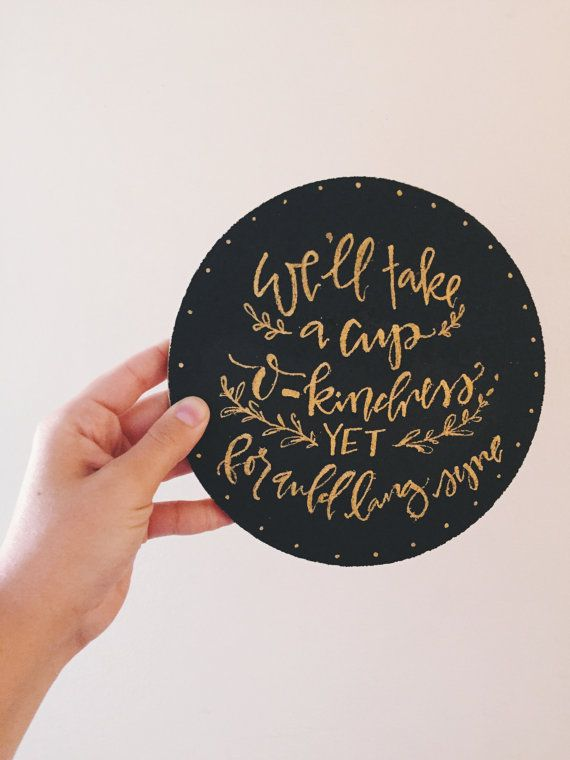 Well take a cup o-kindness yet for auld lang syne  This cork hot pad has a black chalk finish with original hand lettering (by me) in gold paint
