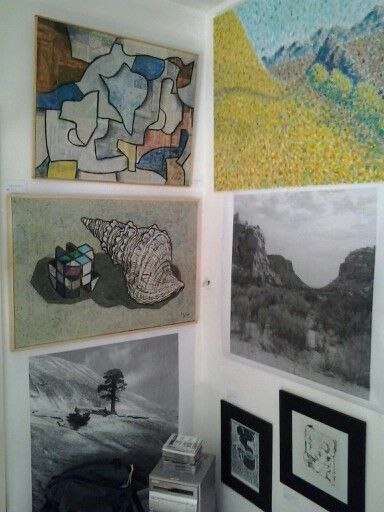 My studio has many paintings on the wall.