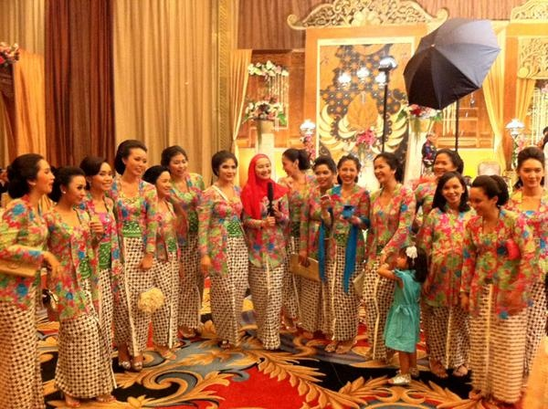 Women in traditional attire at a function, Indonesia.