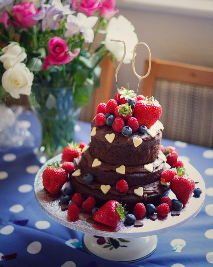 Nigella's chocolate Coca Cola cake recipe as a three-tiered 70th birthday cake! The sponges were decorated with chocolate Coca Cola icing, white chocolate hearts and fresh berries. 🍓🎂 Heather Rowland (@_hefafa_) on Instagram