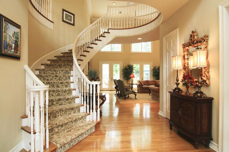 Foyer, with a sweeping circular staircase, opens to the large two story living room. A warm, inviting study is to the left and the spacious dining room to the right. Beautiful hardwood floors, crown mouldings and abundant light.
