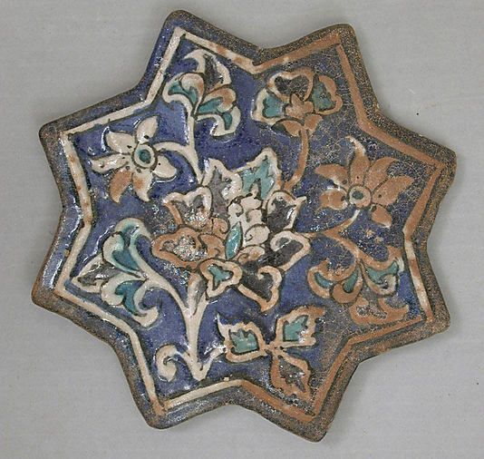 Star-Shaped Tile  Object Name:Star-shaped tile  Date:first half 14th century  Geography:Iran  Culture:Islamic  Medium:Stonepaste; molded and underglaze painted  Dimensions:7.75 in. wide (19.7 cm wide)  Classification:Ceramics-Tiles  Credit Line:Rogers Fund, 1908  Accession Number:08.110.14
