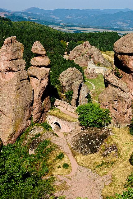 Belogradchik Rocks, Bulgaria. The Belogradchik Rocks are a group of strange shaped sandstone and conglomerate rock formations located on the western slopes of the Balkan Mountains near the town of Belogradchik in northwest Bulgaria. The Belogradchik Rocks have been declared a Natural Landmark by the Bulgarian government and are a major tourist attraction in the region.